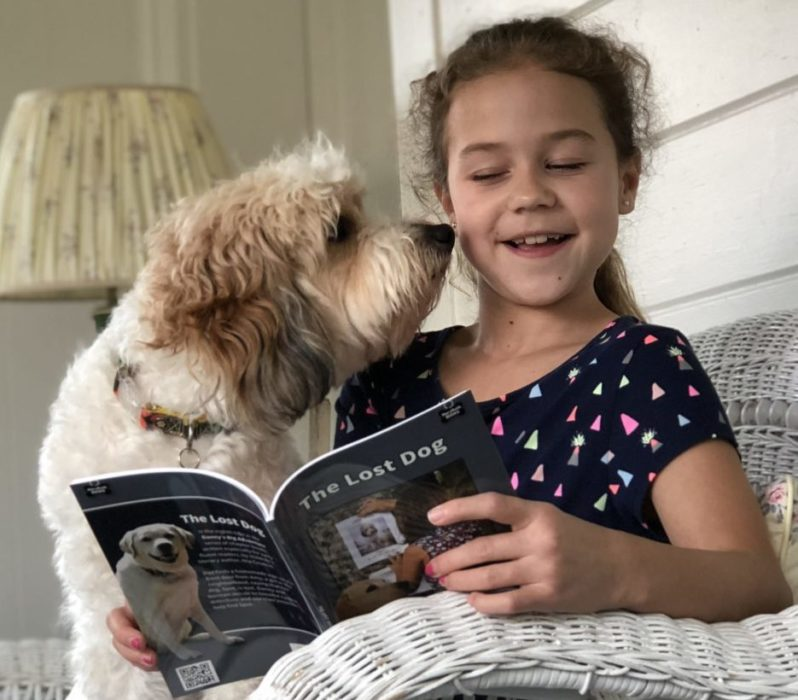 Girl reading The Lost Dog Chapter Book with Spot